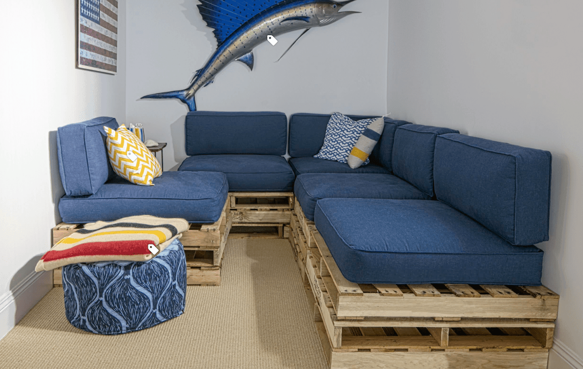 U-shaped pallet sectional with blue cushions