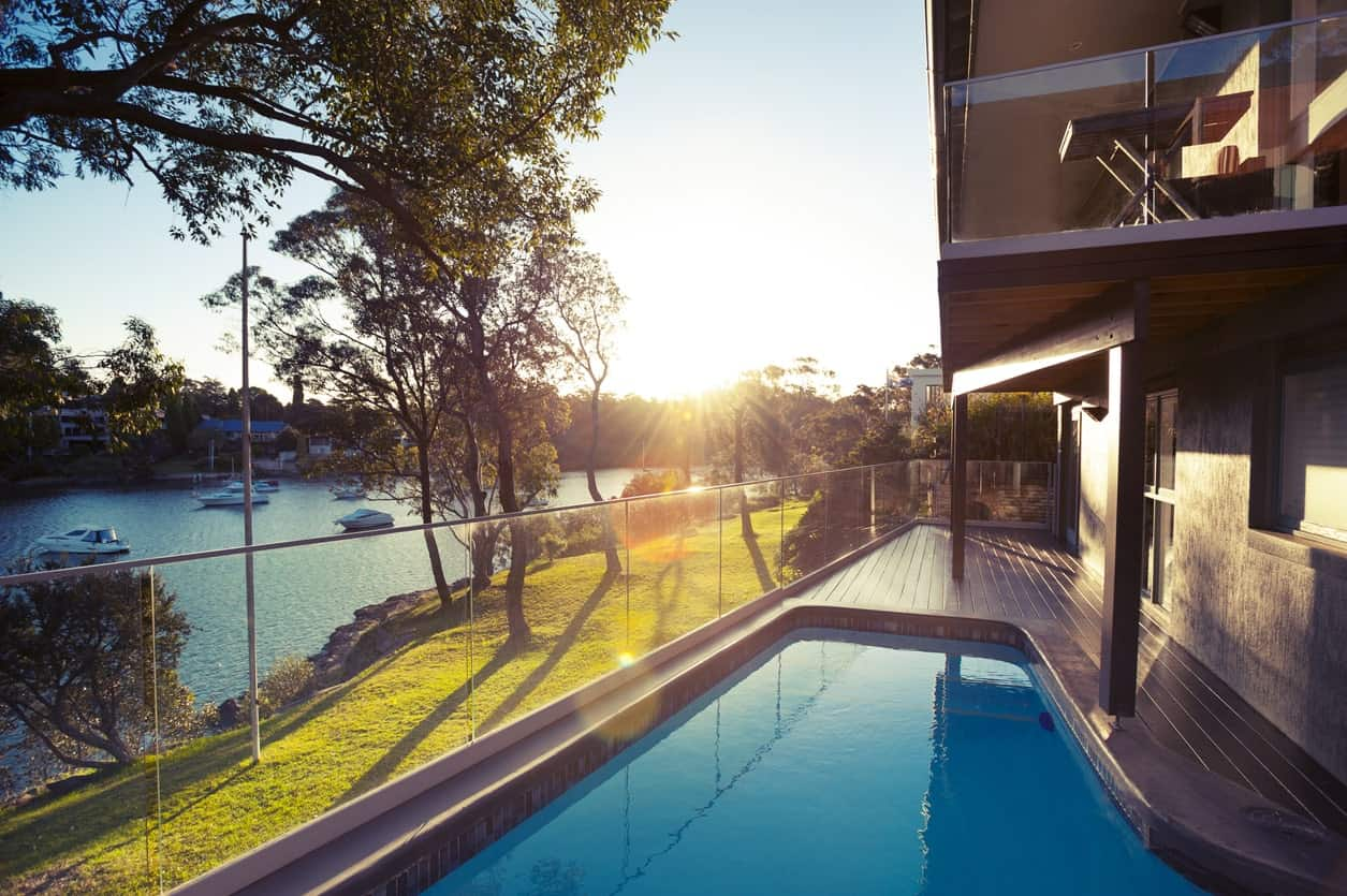 This modern pool-side deck overlooks the beautiful environment surrounding the property.