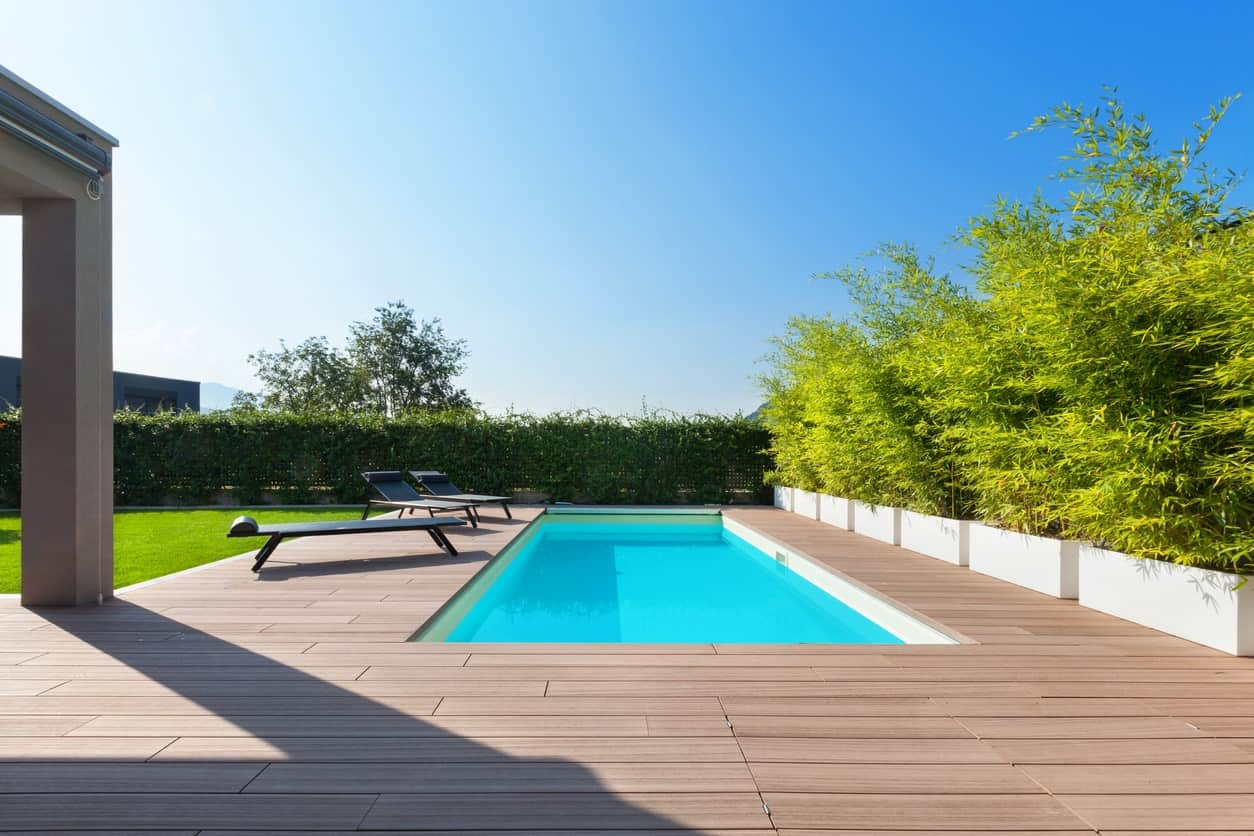 Modern deck surrounding the stunning swimming pool. This deck offers comfortable and stylish lounging seats.