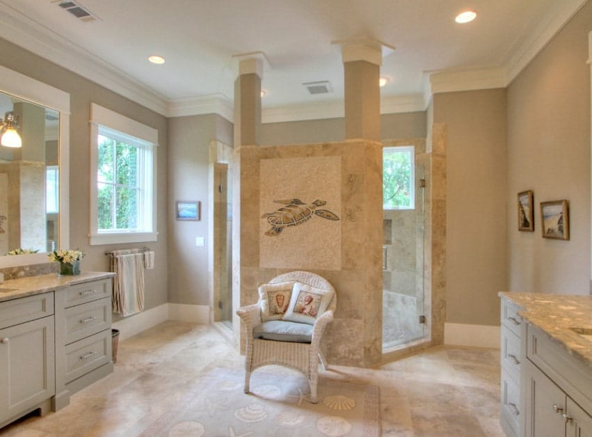 Large primary bathroom with classy floors and stylish shower room. The countertops on both sinks look great together with the bathroom's style.