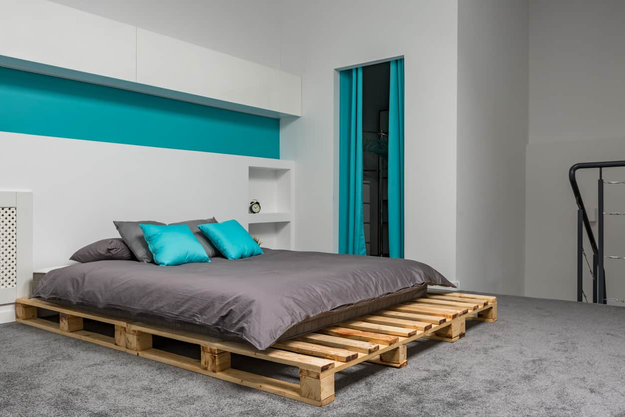 Here's an example of a very simple, one-level pallet bed.  Not the prettiest thing you've ever seen but it does the job and takes pretty much no time to build.