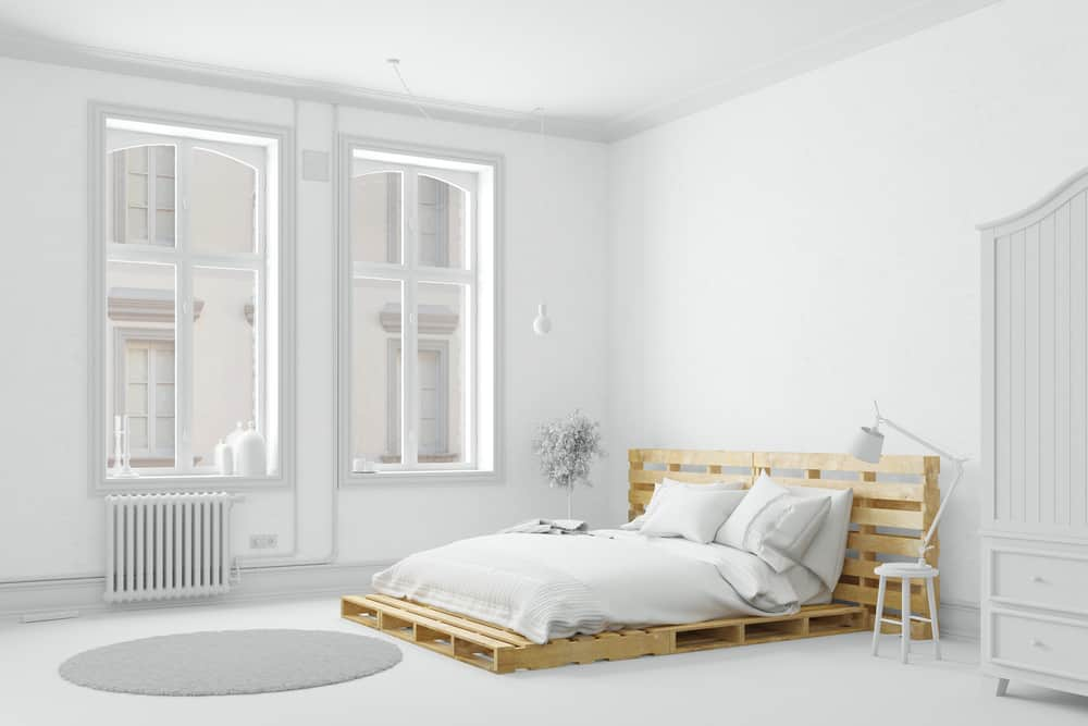 Notice the headboard with this pallet bed is just two pallets standing on end.