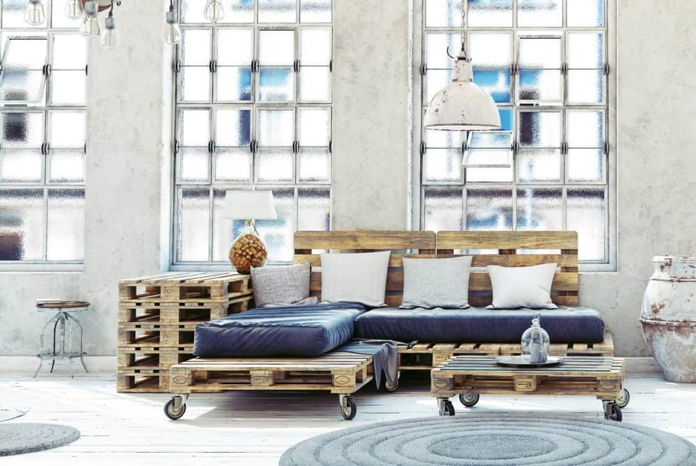 Cool computer rendering of a pallet chaise lounge sofa, pallet end table and matching pallet coffee table on large castor style wheels