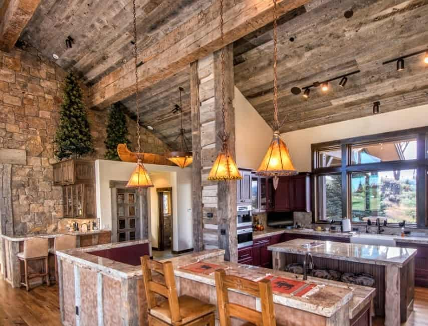 Classy rustic kitchen with shed ceiling lighted by pendant and track lights. The counters and center island offer vintage feels.