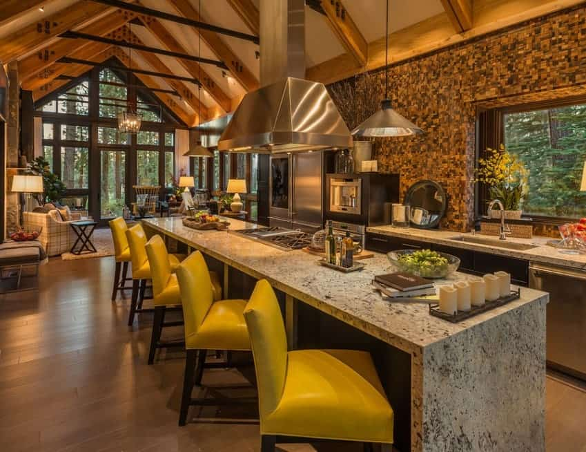 Beautiful kitchen set with long vaulted ceiling with rustic rafters. The wall looks stunning while the lighting is just perfect together with the kitchen's style.