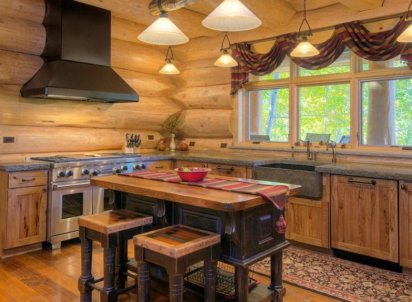 Classy kitchen with rustic finish all over the place. The warm white lights look perfect together with the rustic style of the area.