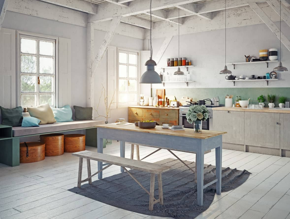 A large Scandinavian kitchen style featuring a white rustic ceiling and flooring. The simple dining table set on the middle adds style to this kitchen.