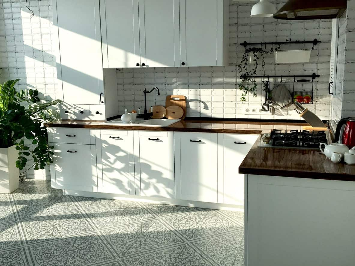 This Scandinavian-Style kitchen boasts elegant tiles flooring along with very smooth rustic kitchen countertops.