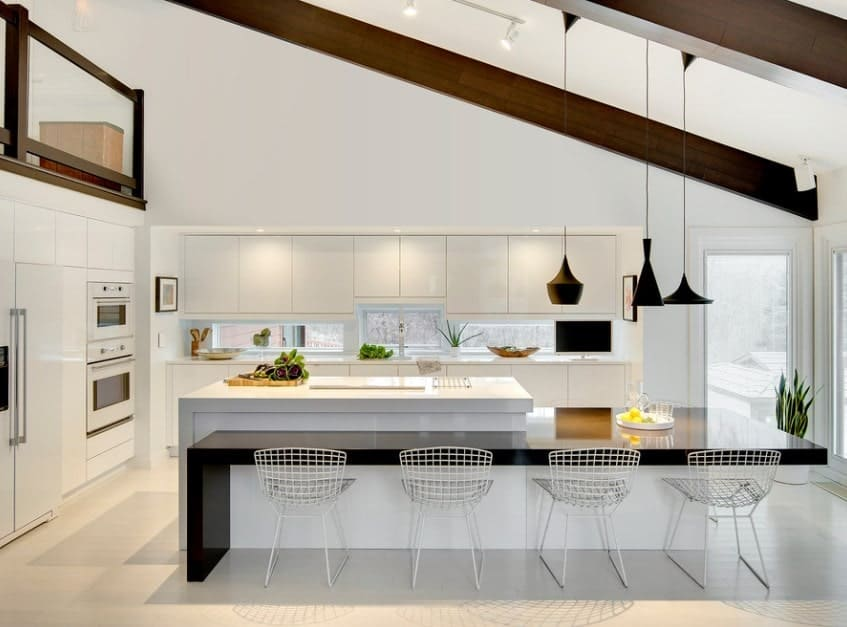 Large Scandinavian kitchen with a very stylish and uniquely designed dining and center island set. The pendant lights look absolutely stylish.