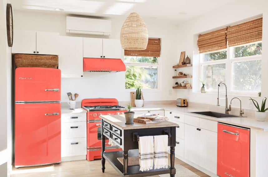 The highlight of this Scandinavian-Style kitchen is the pomegranate-colored elements of the sleek fridge, oven stove and dishwasher that are strategically placed around the room. They give a colorful contrast to the white walls and built-in cabinets and drawers.