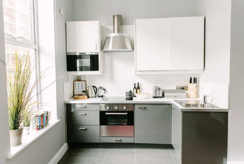 The Scandinavian-Style design is the best fit for this kitchen that has a small floor area. It maximized the walls with an L-shaped peninsula that houses both the sink and cooking area. The vertical space is utilized by hanging cabinets that blend well with the light gray walls.