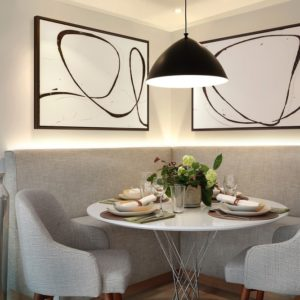 Breakfast nook bench dining area in townhome kitchen