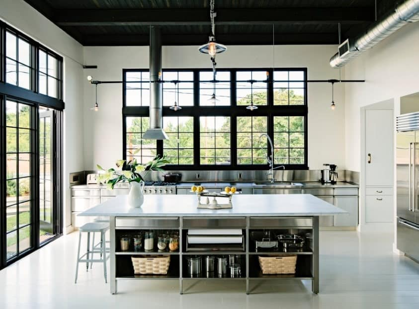 This white kitchen boasts black shade coming from its window frames and a high ceiling. The black shade makes this kitchen looks absolutely gorgeous.