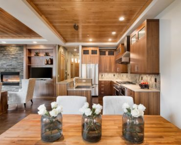 Kitchen with wood tray ceiling and recessed lighting