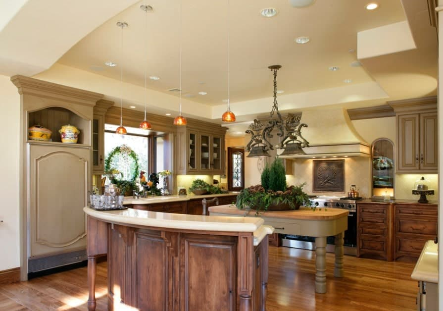 A large kitchen with glamorous kitchen decors and lovely kitchen counters. The tray ceiling looks perfect together with the kitchen's style.