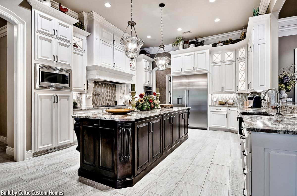 This lovely kitchen has a kitchen island in the middle that has a dark wooden tone to contrast the rest of the kitchen's cabinetry, floor tiles and ceiling that has a light gray hue.