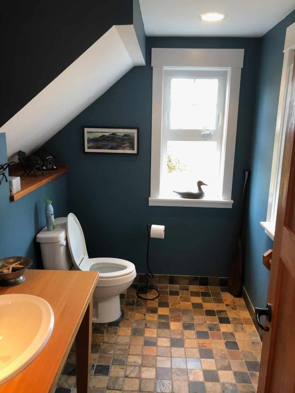 I love the blue color scheme and decor of the powder room on the main floor.