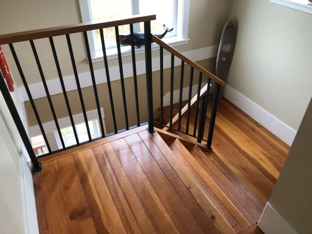 This is a photo of the top of the stairs leading to the hallway that takes you to the 3 bedrooms and 3 bathrooms.