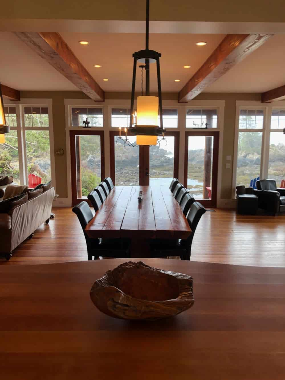 Here's a great photo of the huge dining room table from behind the kitchen island.