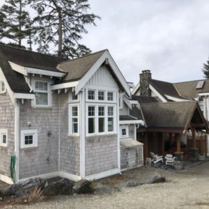 This vacation rental beach house is 2 separate houses on the beach joined together by a large hall.