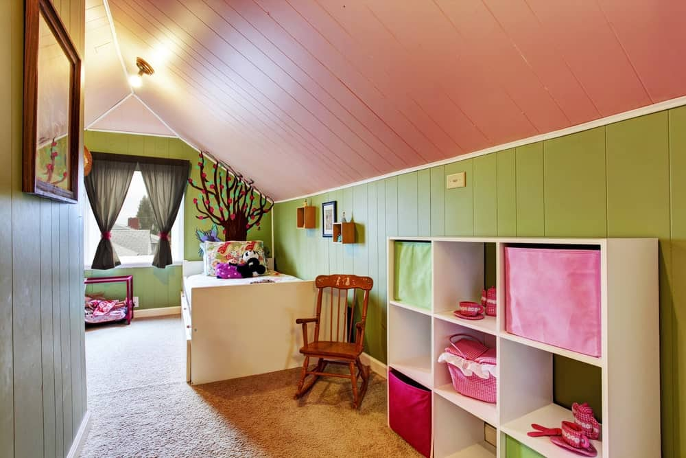 The green walls and vaulted red ceiling make this children's bedroom looks so attractive.