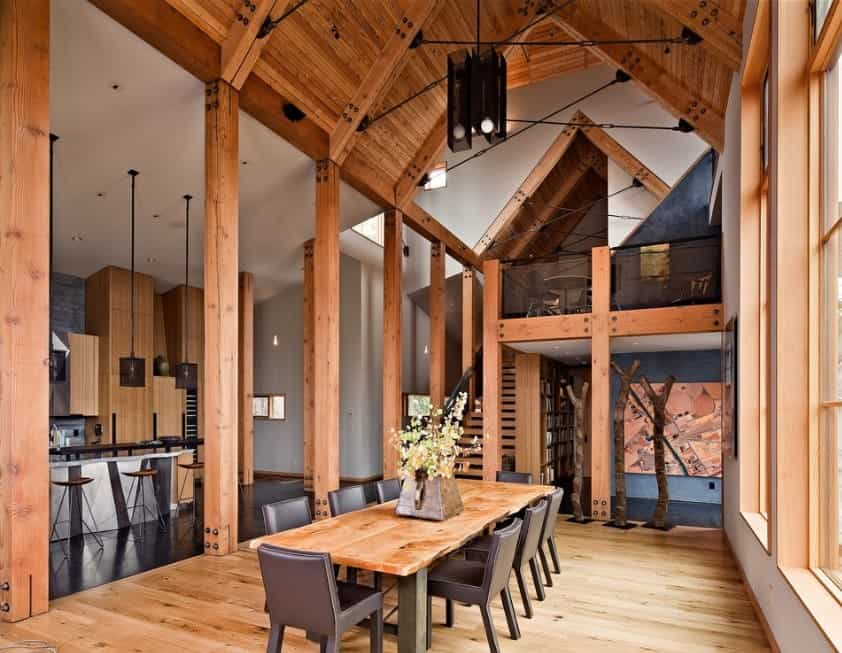 A staggering home design featuring hardwoods all over the place. The vaulted ceiling adds style to the home as well.