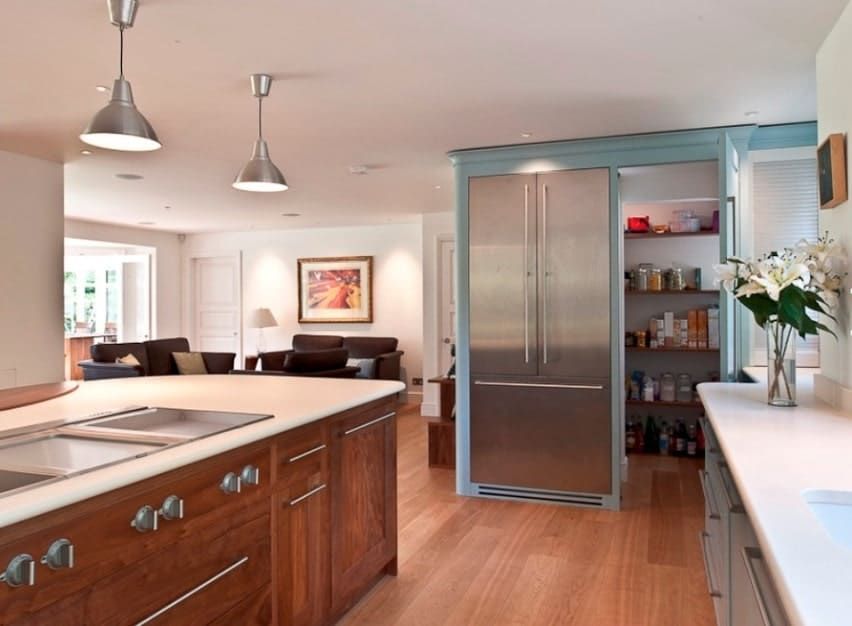 This kitchen features a uniquely designed pantry. This idea is an absolute genius.