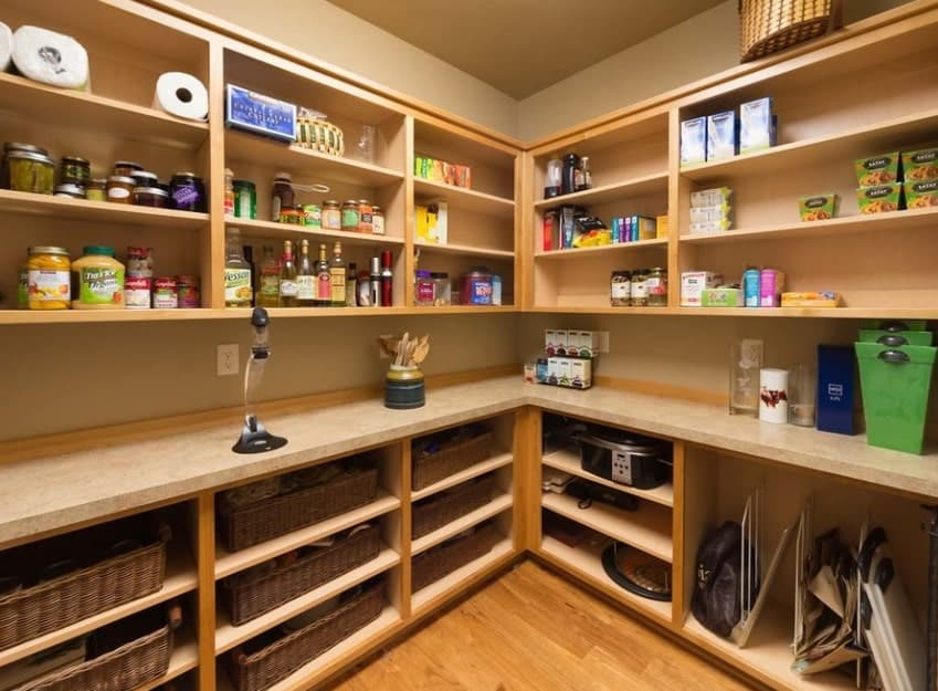 Large walk-in pantry with walnut finished shelving. The marble countertops look absolutely gorgeous.