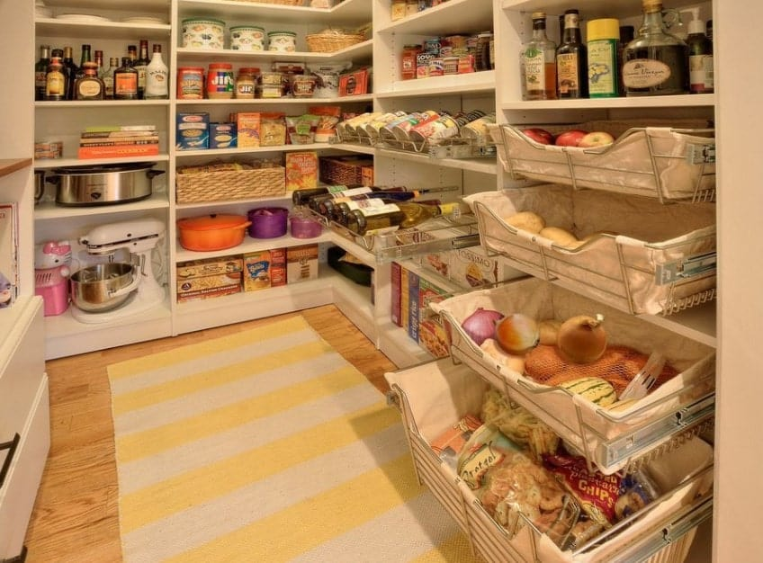 Large pantry with a hardwood flooring topped by yellow striped rug.