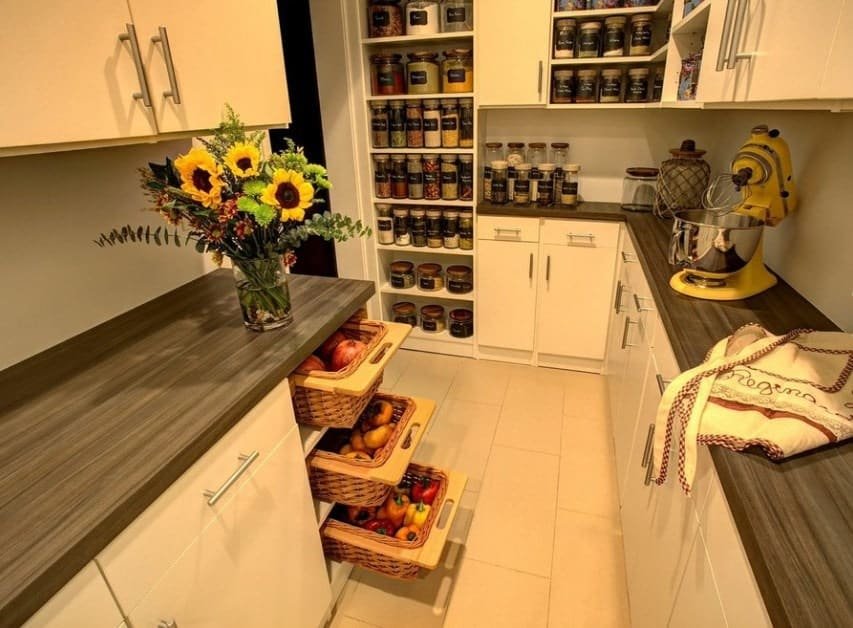 Large pantry featuring tiles flooring, white counters and rustic countertops.