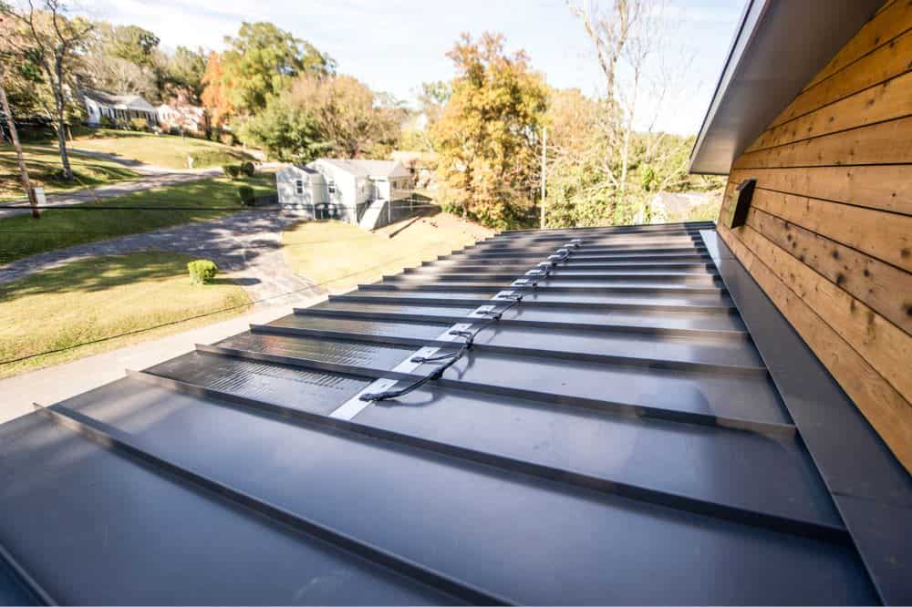 Charcoal grey standing seam metal roof, adhesive solar panels
