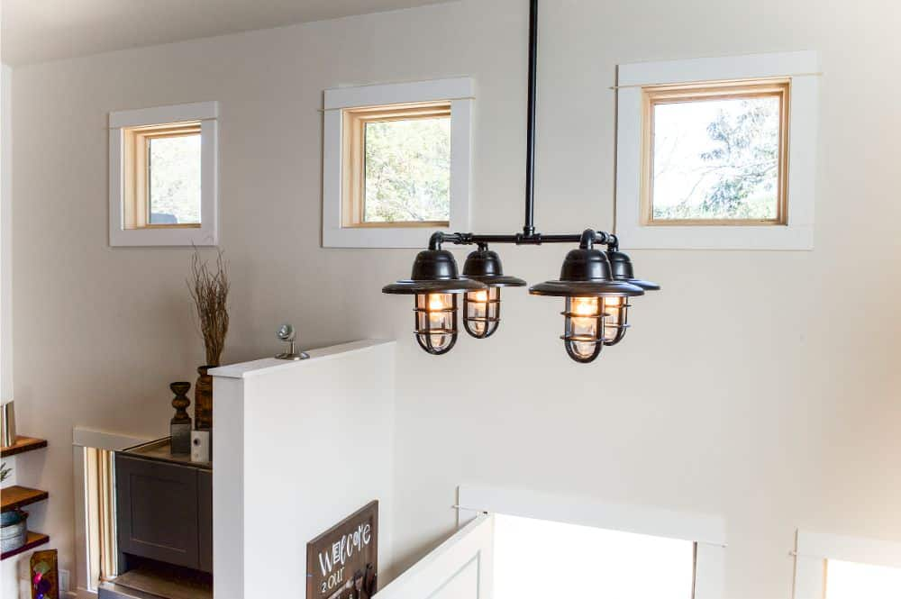 Spotlight for accent wall with paddle board, Edison bulb and steel pipe chandelier, picture windows