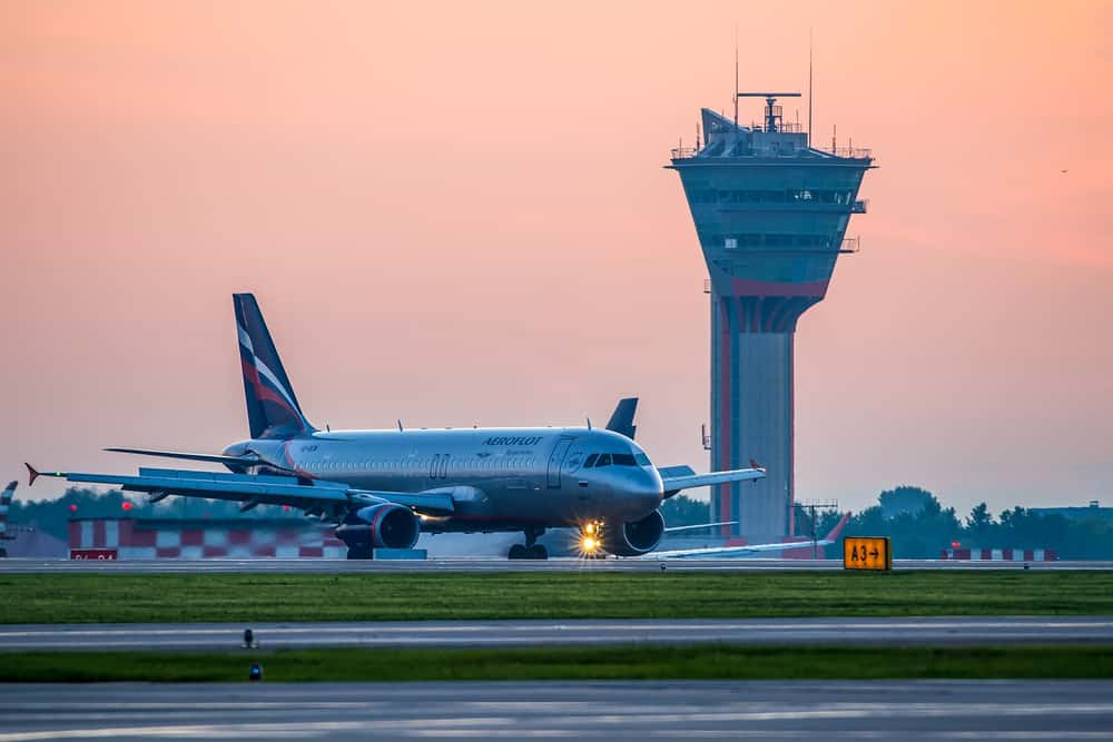 Airbus A320 Aeroflot VQ-BCM taxiing to terminal after landing at Sheremetyevo international airport at sunrise in Moscow