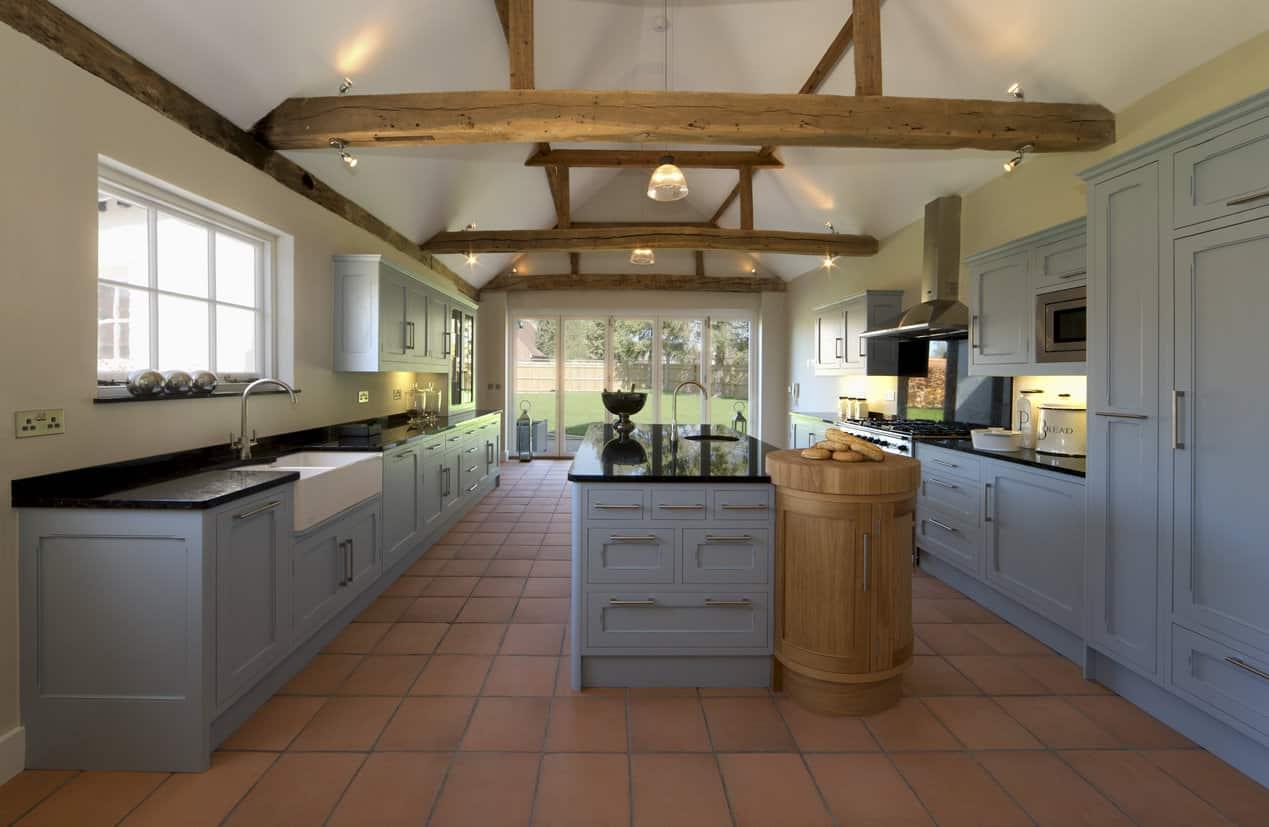 Powder blue kitchen cabinets in old restored barn