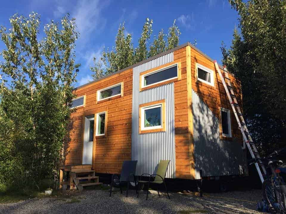 Photo of a wood and corrugated metal exterior Tiny house.