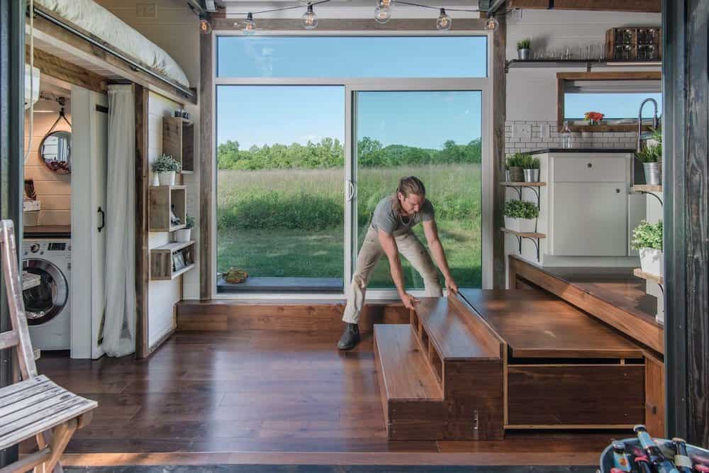 Dining table pulls out from underneath in tiny house living room