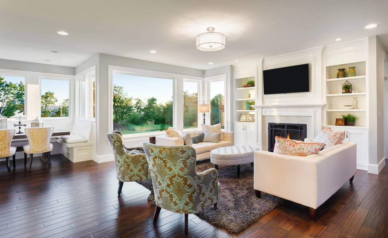 Elegant formal white living room in open concept space