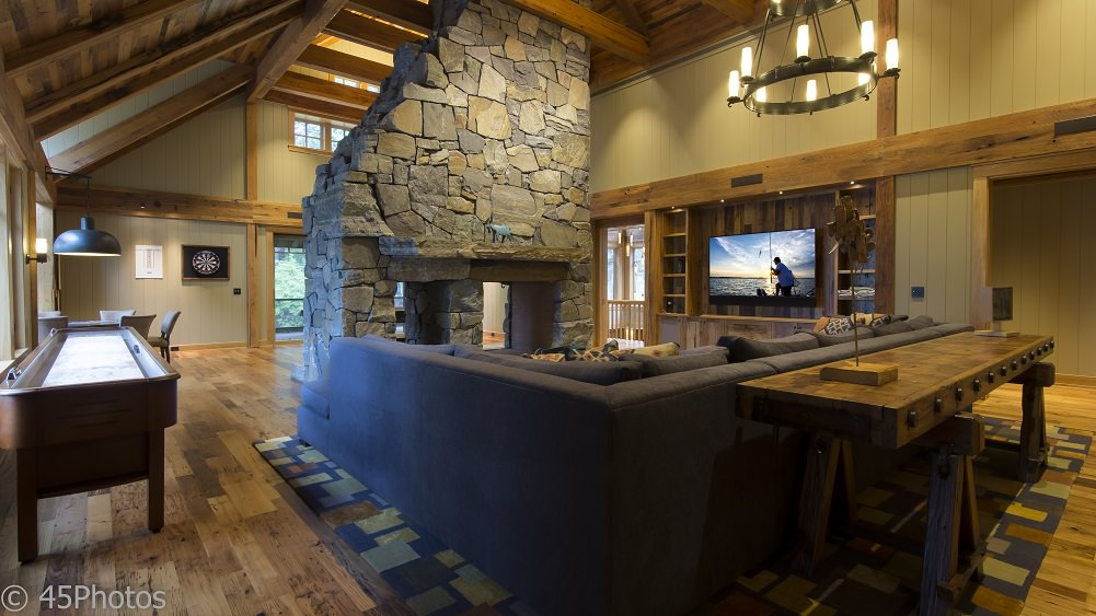 Large rustic family room with great media system by DC Home Systems.