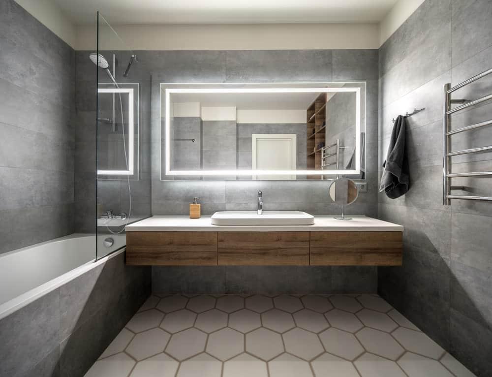 A bathroom with a giant mirror