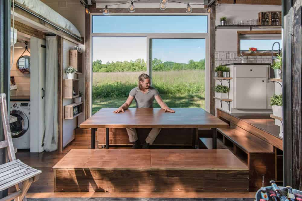 Living room in tiny house is now a full dining room