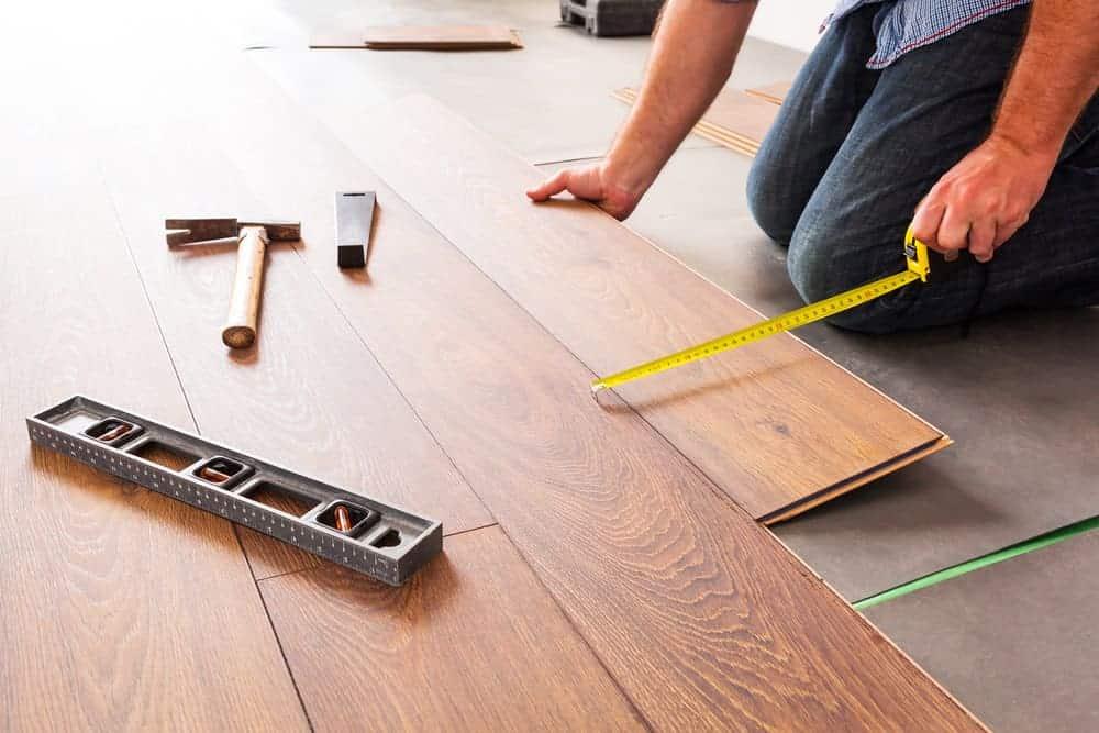 Man installing laminate flooring