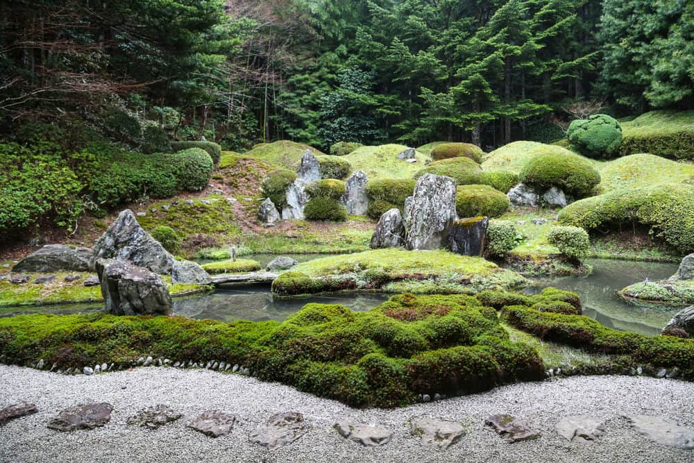 Peaceful Japanese Zen Garden with Pond, Rocks, Gravel and Moss