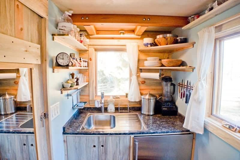 Here's a kitchen in its own little room inside a tiny house on wheels. It sure is cute with miniature everything. There are two windows which add plenty of light. I think you could definitely prepare decent meals in there - but it's probably best to cook solo. Too many cooks in the kitchen as they say - applies here for sure.