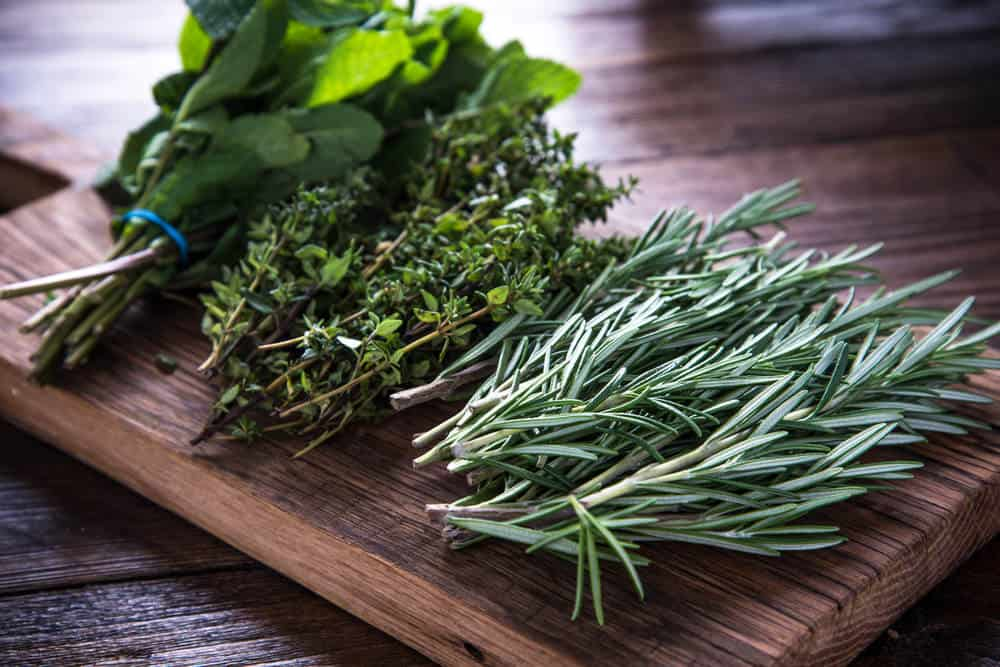 Several herbs on cutting board