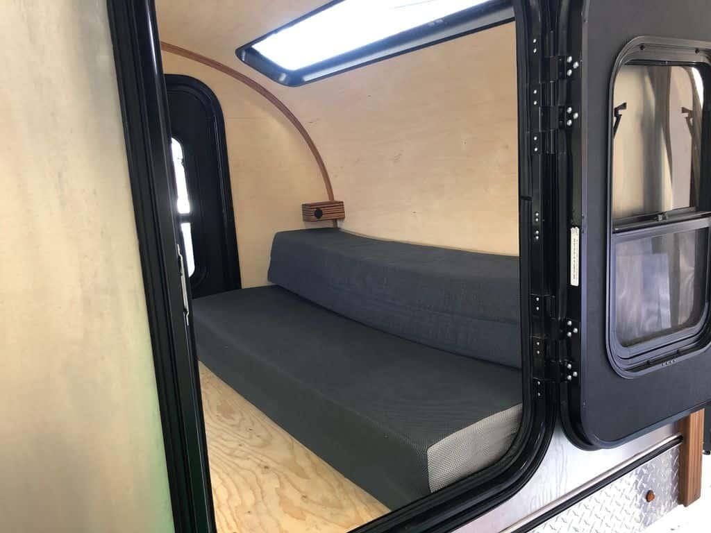 Sofa trifold mattress inside teardrop trailer