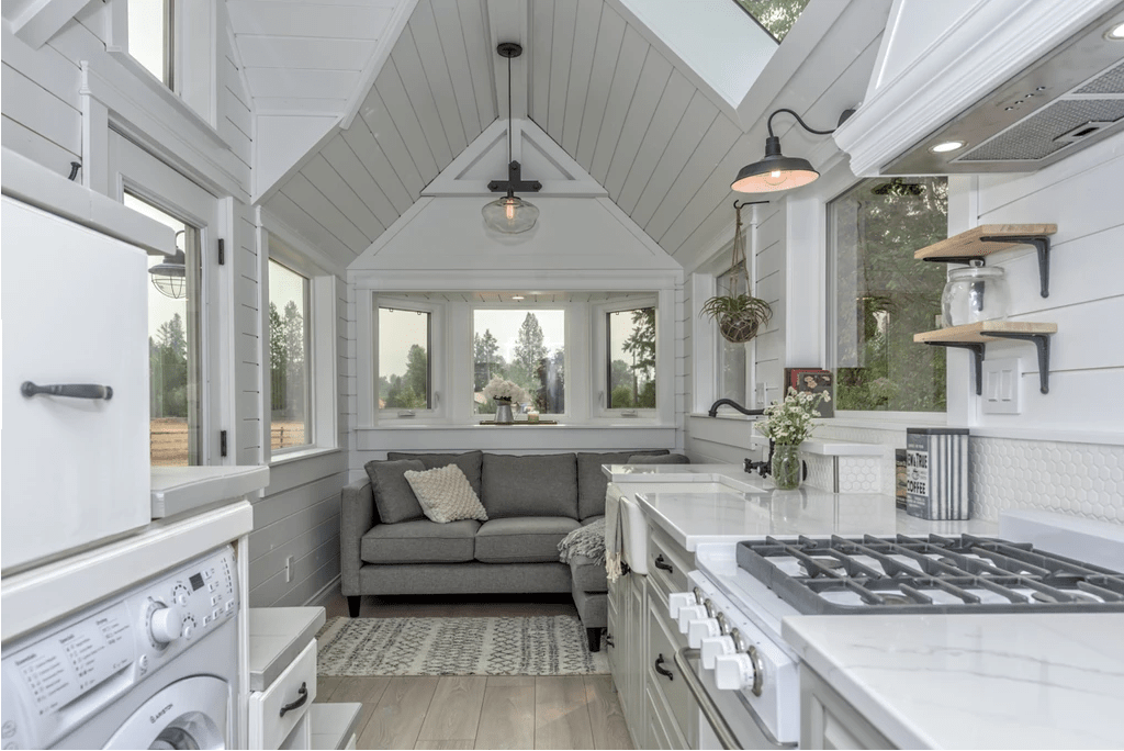 The living room in this tiny home includes a regular sofa (very comfortable), cathedral ceiling and sizeable kitchen.