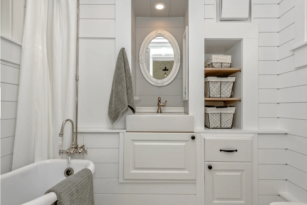 Notice the clever sink design how it's built into a wall of bathroom storage cabinets.