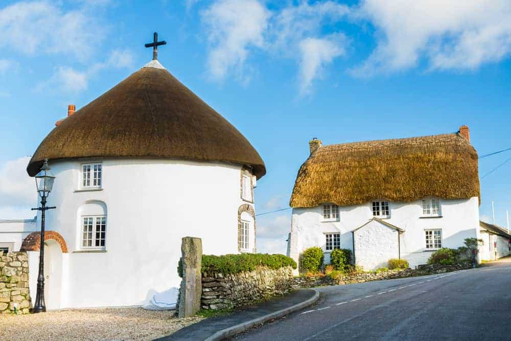 Thatched roof white round house in England