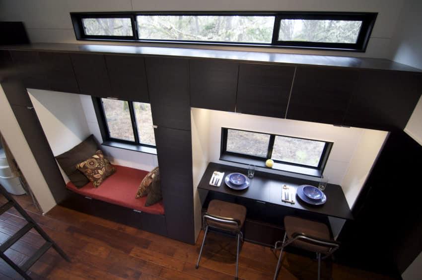 Tiny house with window nook sofa living room