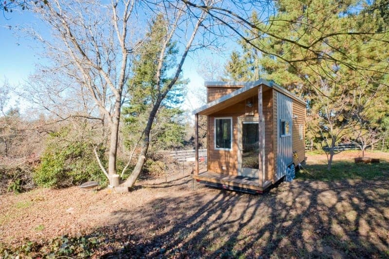 Exterior photo of a tiny house with a shed-style roof.